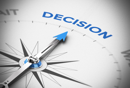 Realistic concept of decisionmaking. Compass needle pointing the blue word decision over a paper background